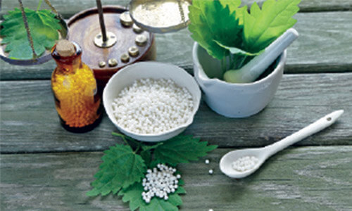 Picture of Homeopathic medicine used in dental work.  The picture shows a bowl and a bottle with Homeopathic medicine.